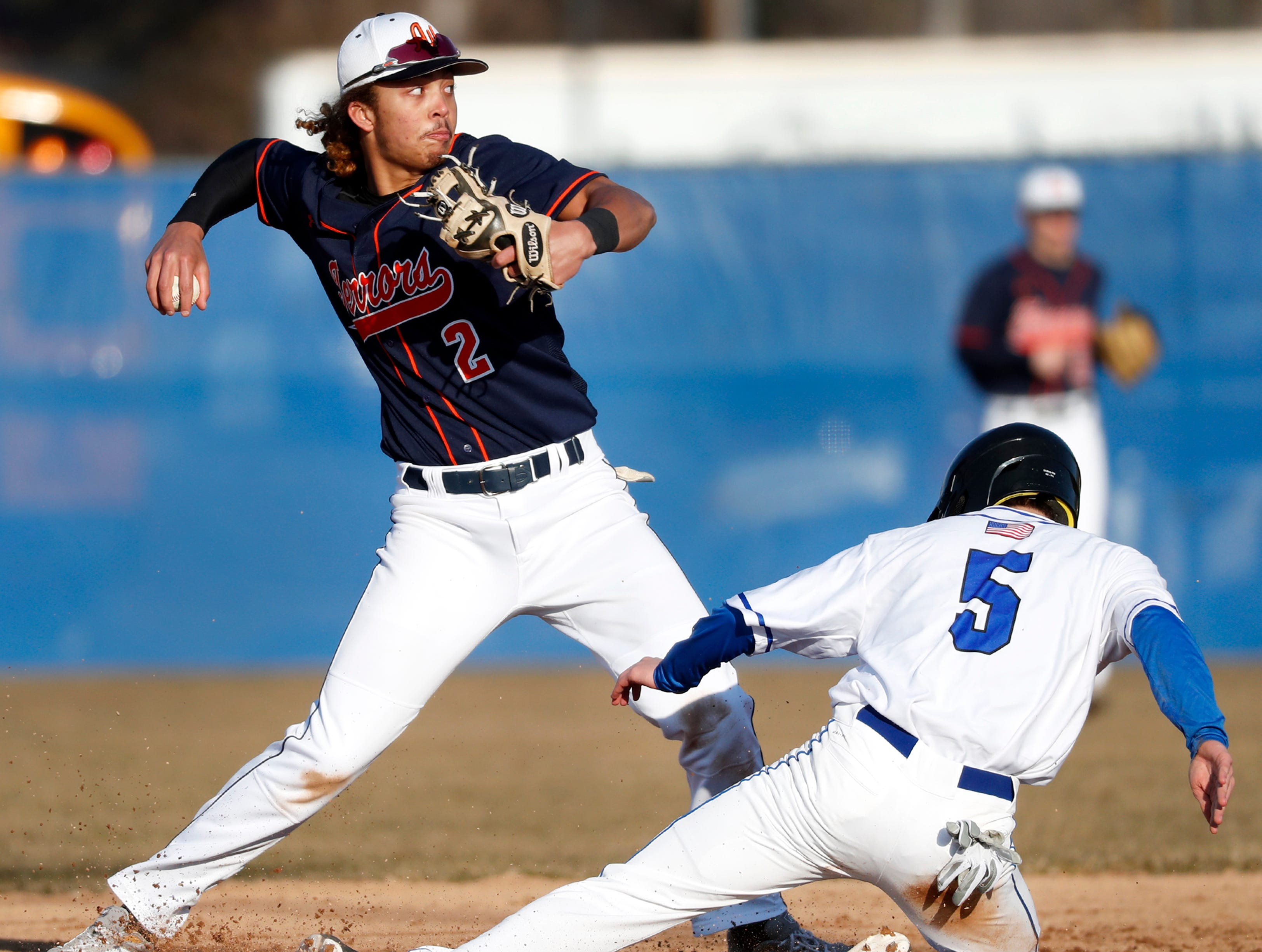 Appleton West High School's Bubba Thompson forces Oshkosh West High School's Alex Grey out at second Tuesday, April 2, 2019, at Nienhaus Field in Appleton, Wis. Appleton West defeated Oshkosh West 9-2.Danny Damiani/USA TODAY NETWORK-Wisconsin
