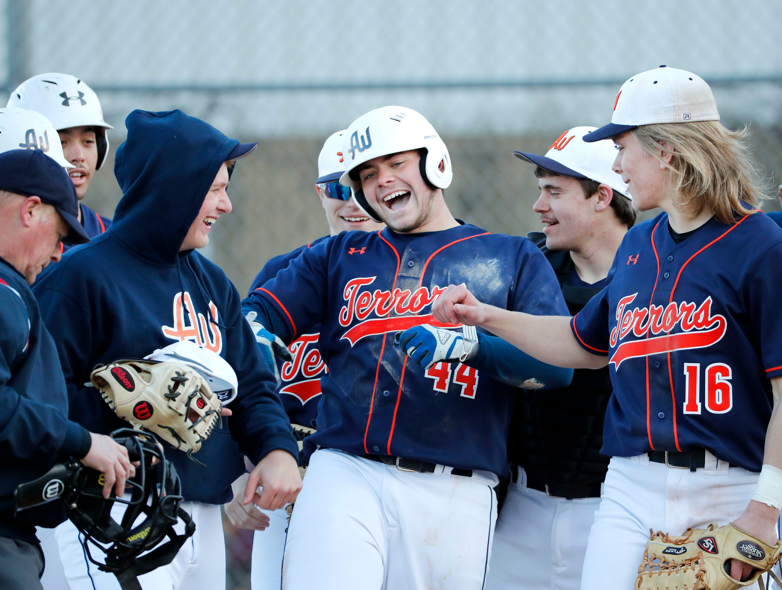 Appleton West's Tyler Tetzke celebrates after hitting a home run against Oshkosh West Tuesday, April 2, 2019, at Nienhaus Field in Appleton, Wis. Appleton West defeated Oshkosh West 9-2.Danny Damiani/USA TODAY NETWORK-Wisconsin