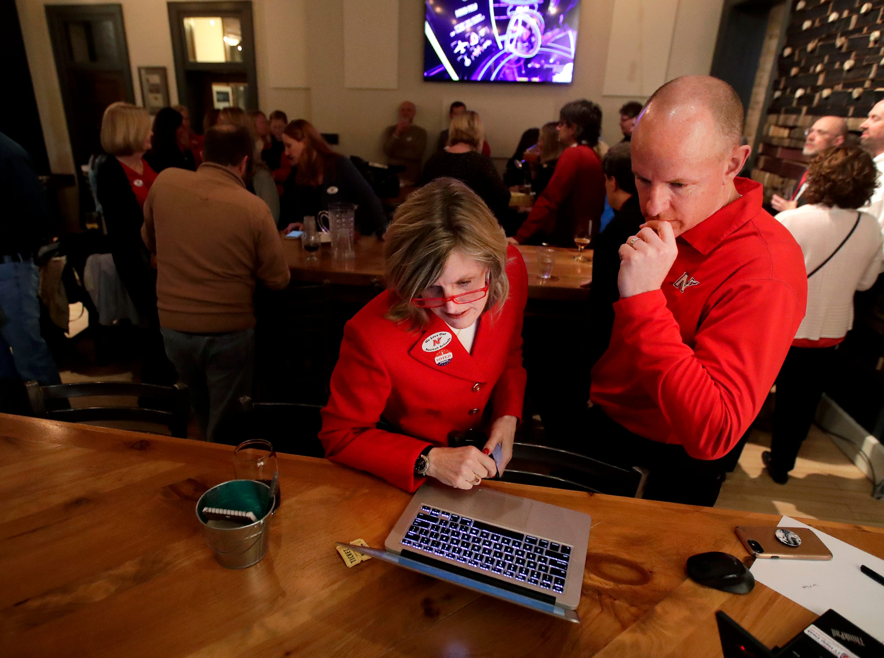 Mary Pfeiffer, Neenah Joint School District superintendent, and Jim Strick, Neenah Joint School District communications manager, watch as final referendum results are updated before Pfeiffer told supports that it didn't pass Tuesday, April 2, 2019, at Lion's Tail Brewing Co. in Neenah, Wis. The $129.6 million referendum lost by 497 votes and would have been the largest in the history of the fox cities.Danny Damiani/USA TODAY NETWORK-Wisconsin