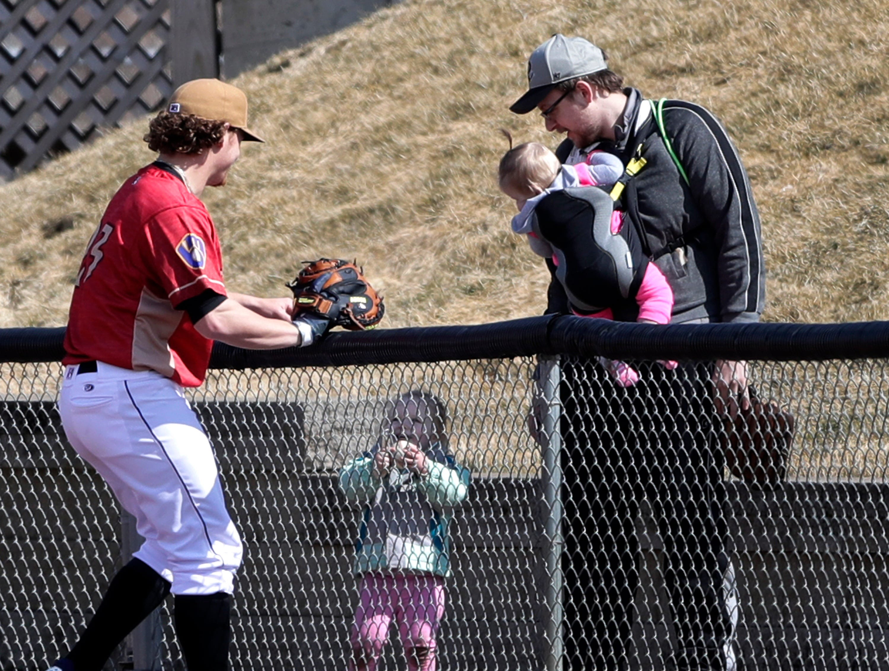 The Wisconsin Timber Rattlers' pitcher #23 Scotty Sunitsch hands a ball to a fan during Fan Fest at Neuroscience Group Field at Fox Cities Stadium on Tuesday, April 2, 2019, in Grand Chute, Wis.Wm. Glasheen/USA TODAY NETWORK-Wisconsin.