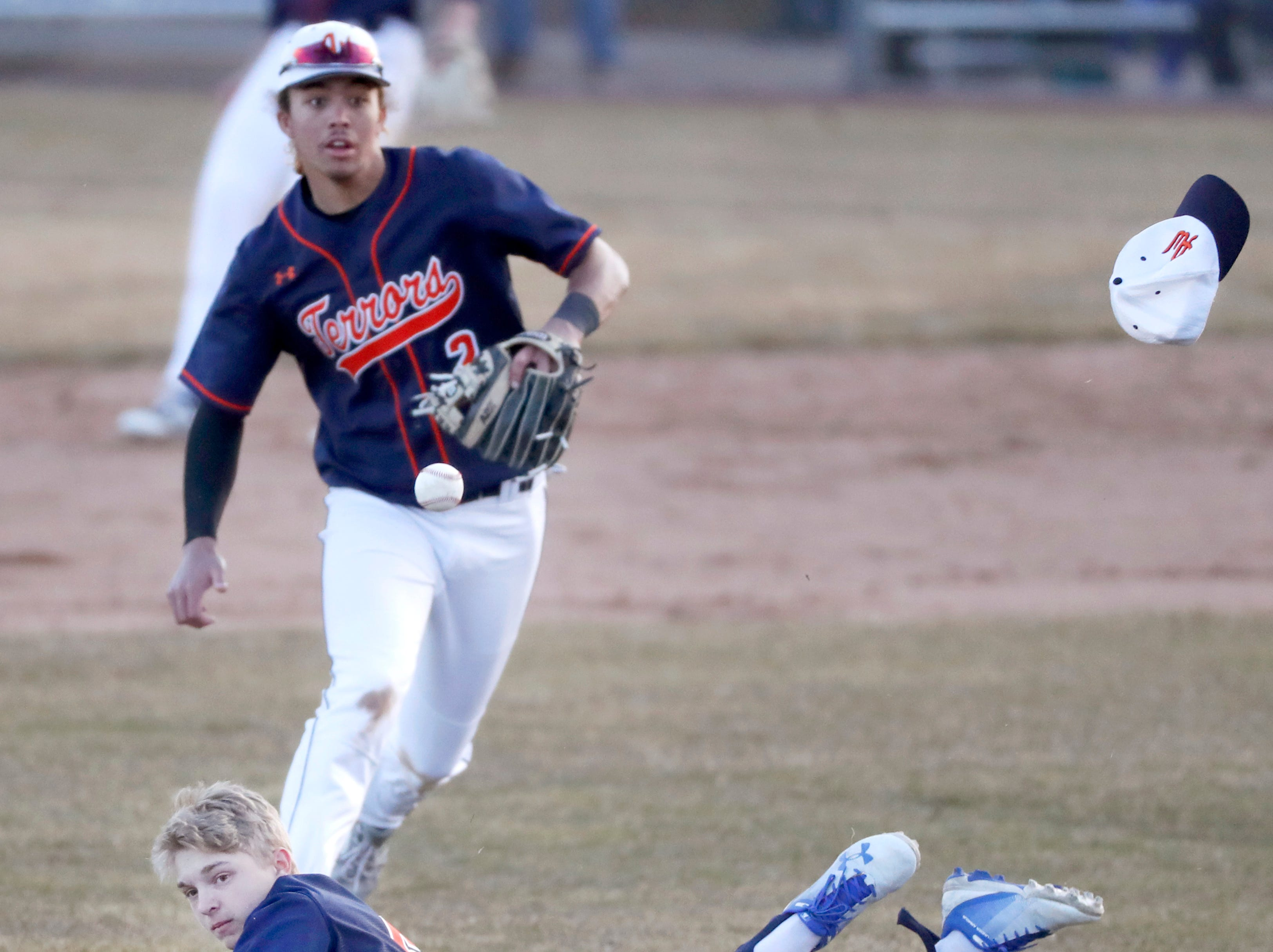 Appleton West High School's Nick Lavigne hits the ground after missing a catch against Oshkosh West High School Tuesday, April 2, 2019, at Nienhaus Field in Appleton, Wis. Appleton West defeated Oshkosh West 9-2.Danny Damiani/USA TODAY NETWORK-Wisconsin