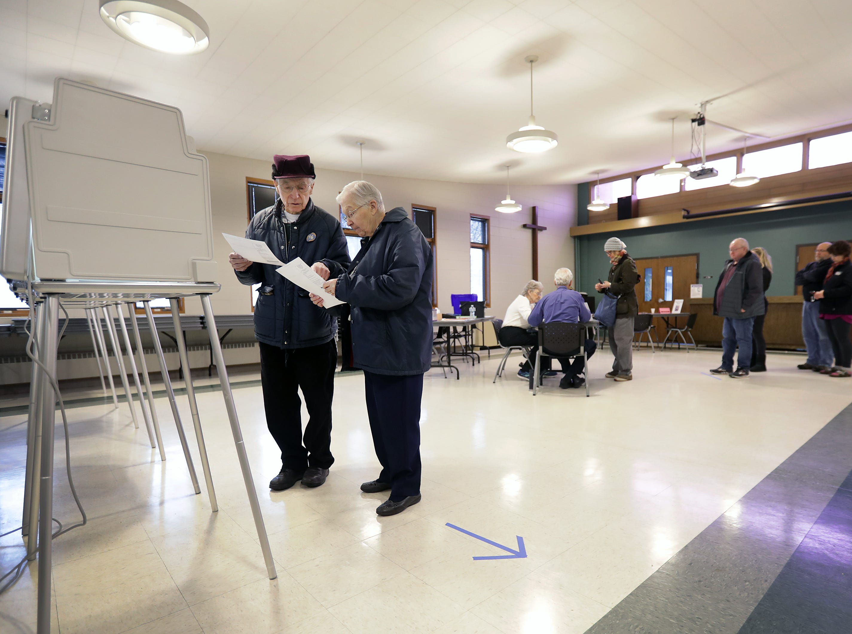 Jim and Dorothy Francart look over their ballots before filling them out as voters head to the polls at Peace Lutheran Church on Tuesday, April 2, 2019, in Neenah, Wis.Wm. Glasheen/USA TODAY NETWORK-Wisconsin.