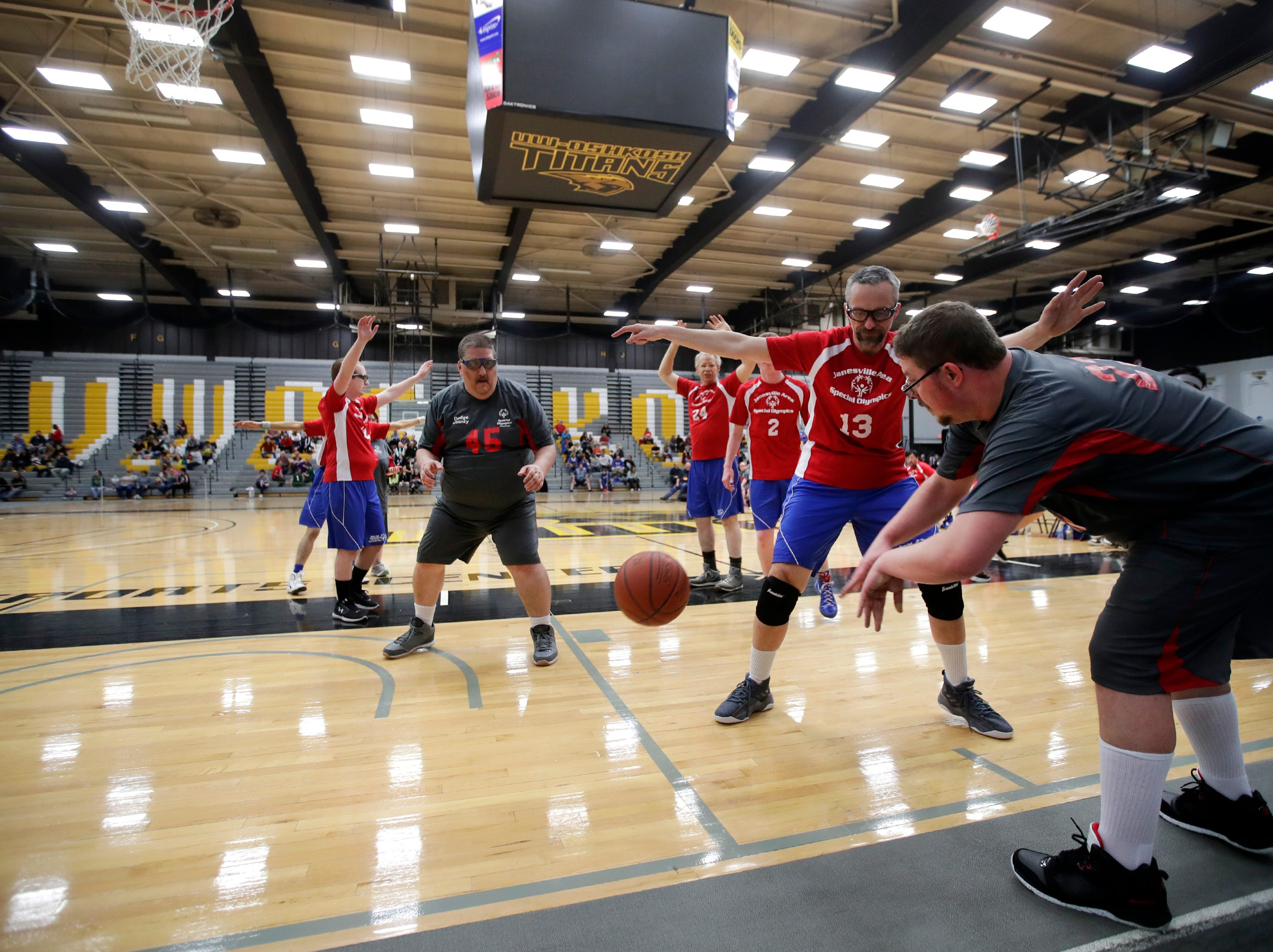 Dodge County Eagles' Allen Lynard gets a pass off to teammate Mike Huebner while playing against the Janesville Jets during the 2019 Special Olympics State Indoor Sports Tournament Saturday, April 6, 2019, at the Kolf Sports Center in Oshkosh, Wis. Danny Damiani/USA TODAY NETWORK-Wisconsin