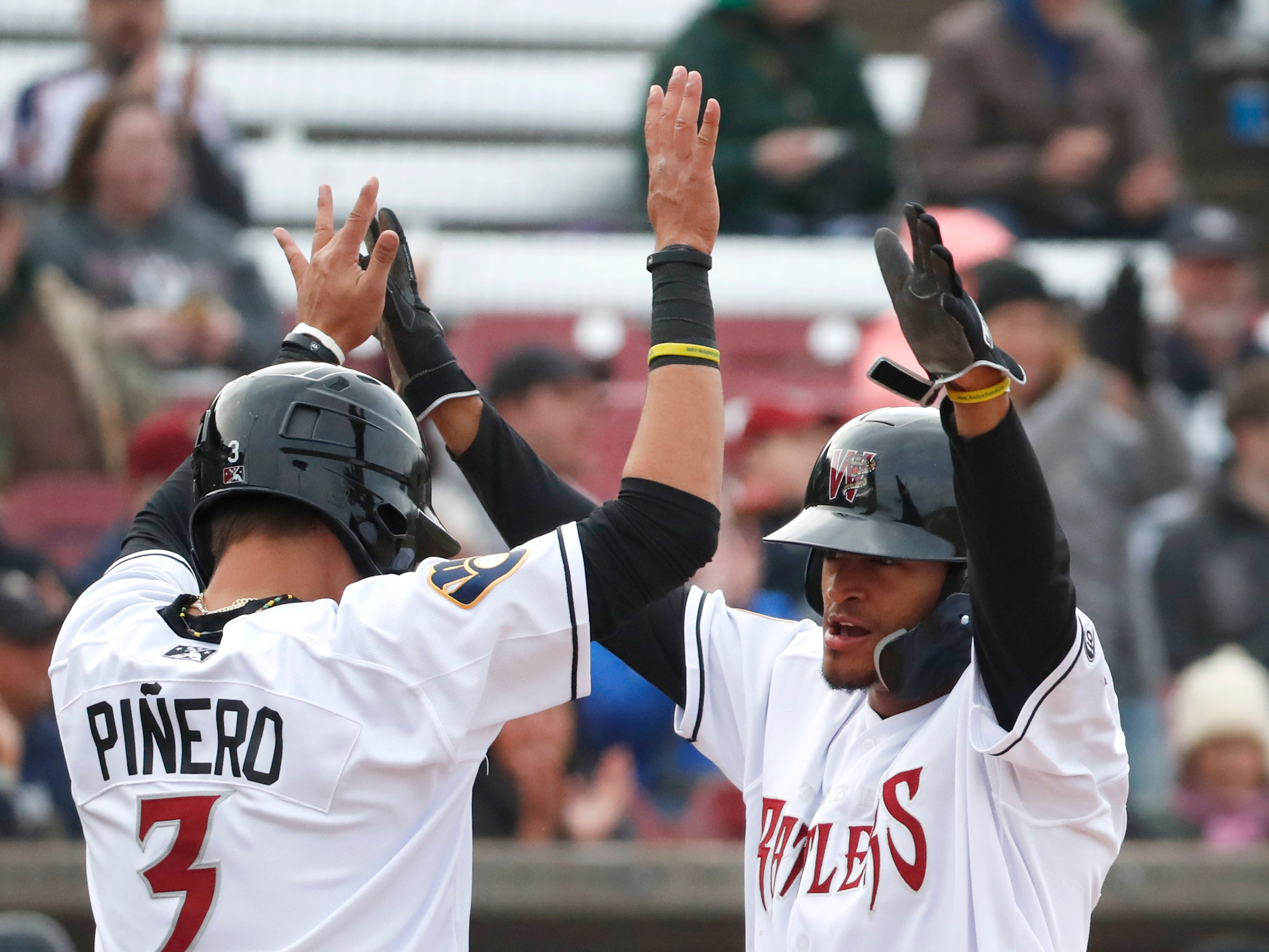 The Timber RattlersÕ Antonio Pinero and Pablo Abreu celebrate after they scored the only runs of their home opener against the Cedar Rapids Kernels Saturday, April 6, 2019, at Neuroscience Group Field at Fox Cites Stadium in Grand Chute, Wis. Danny Damiani/USA TODAY NETWORK-Wisconsin