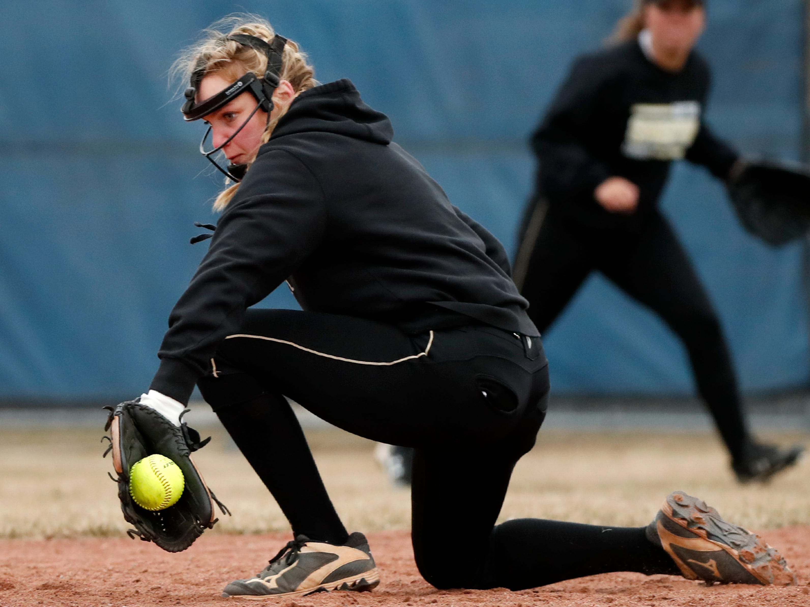 Oshkosh North High SchoolÕs Brooke Ellestad catches a ground ball during their game against Appleton East High School Thursday, April 4, 2019, in Appleton, Wis. Danny Damiani/USA TODAY NETWORK-Wisconsin
