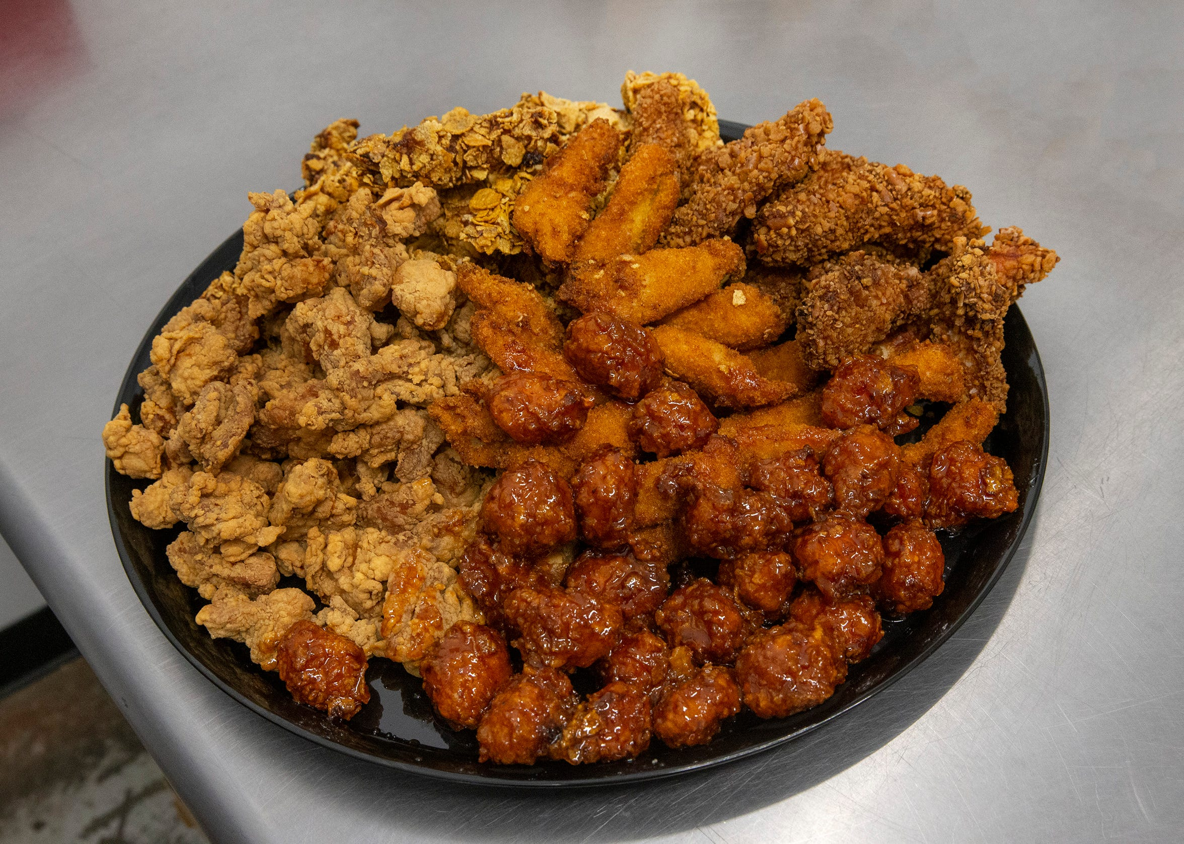 "A chicken platter at Mike's Chicken Crunchers, a ""chicken speakeasy"" of sorts tucked inside an industrial park at 40 Chestnut St. in Lakewood."