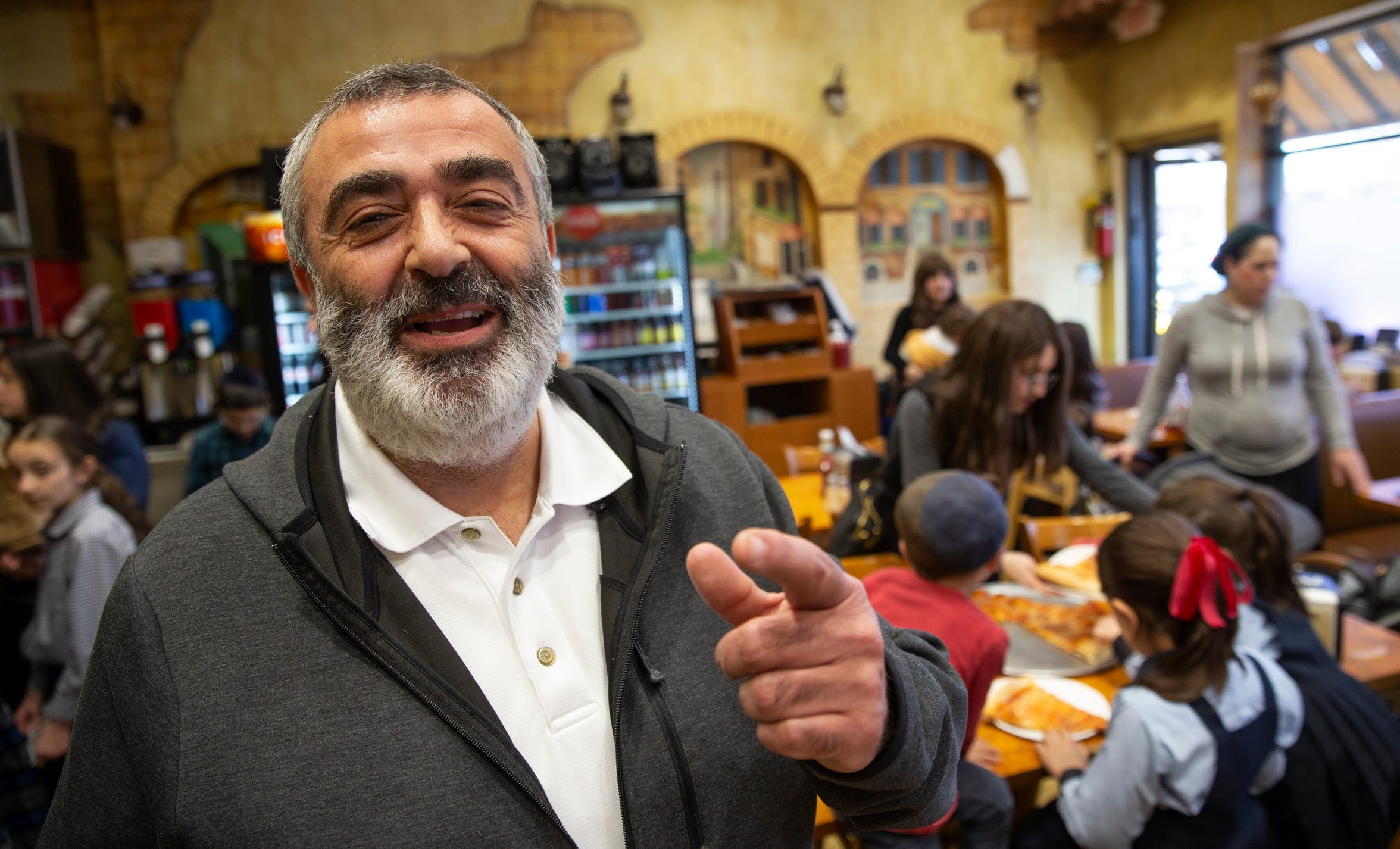Moshe Lankry, owner of Pizza Plus, in the dining room of his busy restaurant at 241 Fourth St. in Lakewood.