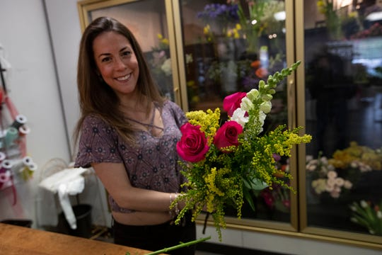 """Cortney Costa works on a bouquet.  """"A Country Flower Shoppe & More,"""" a 20-year-old Colts Neck-based flower shop taken over by mother-and-daughter duo Marie and Cortney Costa in spring/summer 2018. The store is not only a florist but sells a variety of home furnishings, and decorative items including jewelry, and stuffed animals."""