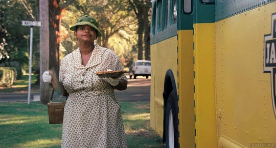 "Minny (Octavia Spencer) exits the bus to deliver a special pie to her former employer in ""The Help,"" which is showing Friday-Saturday at the Paramount Theatre."