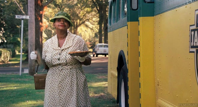 """Minny (Octavia Spencer) exits the bus to deliver a special pie to her former employer in """"The Help,"""" which is showing Friday-Saturday at the Paramount Theatre."""