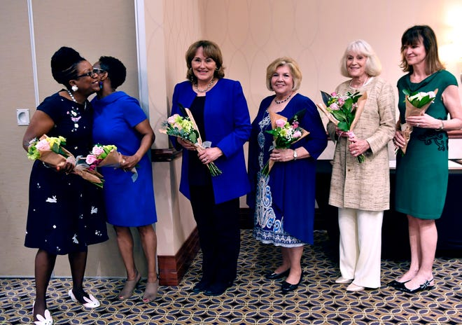 Noreen White (left) and Felicia Hopkins congratulate each other as they and Carolyn Beckham, Shirley Anderson, Yvonne Batts and Leigh Black were honored Monday. It was the 10th annual Women of Outstanding Achievement/Women of Promise & Courage Scholarship Award Luncheon, sponsored by the Abilene chapter of the American Association of University Women and held at Abilene Christian University.