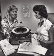 Etta Smith, vice president of AAUW, left reviews slides with Terri Ross, study chairperson, in August 1976.