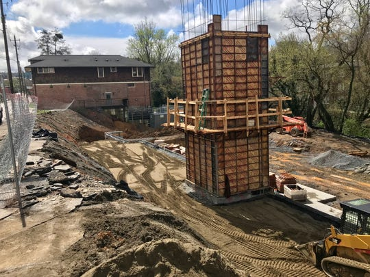 A 36-unit apartment complex is under construction on Broadway Street in Asheville at the site of the former Bob Lawrence Power Equipment.