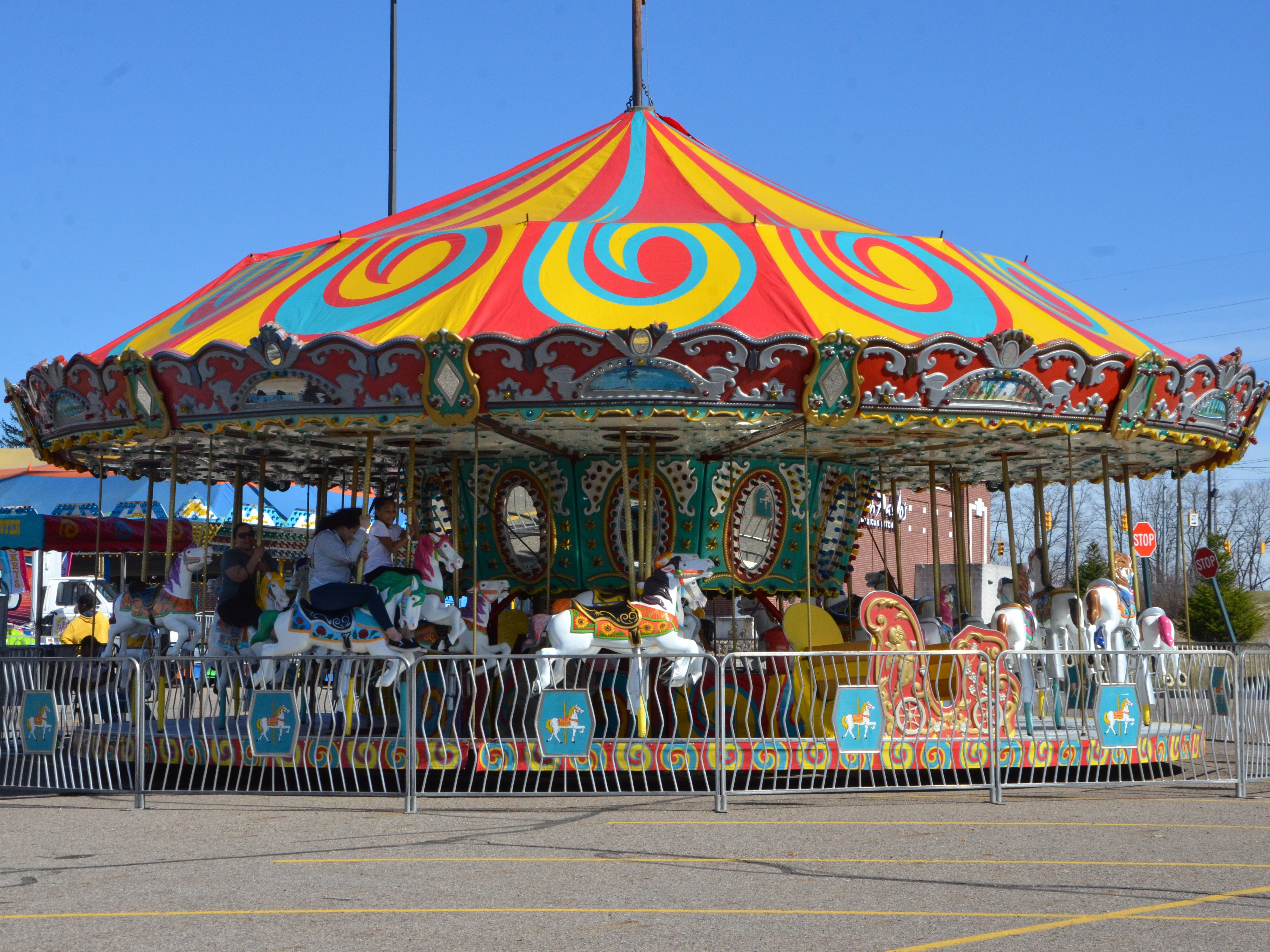 A merry-go-round in the parking lot of Lakeview Square Mall.
