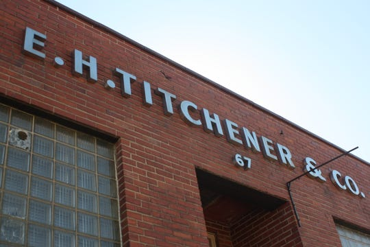 The building that formerly housed E.H. Titchener & Co. is on the corner of Titchener Place and Clinton Street.