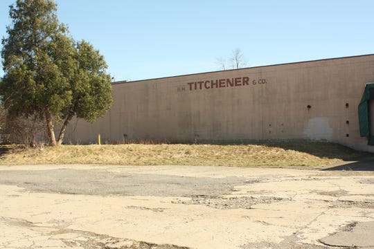 E.H. Titchener & Company was formerly located in a large warehouse on the corner of Titchener Place and Clinton Street.
