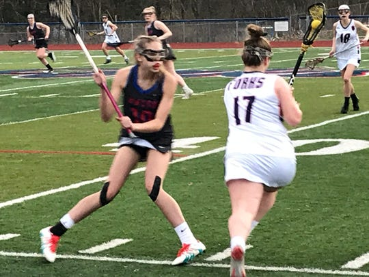 Chenango Forks' Robin Confer maneuvers around Owego's Hannah Monell during the first half of Monday's game at Forks. The Blue Devils won, 8-7.