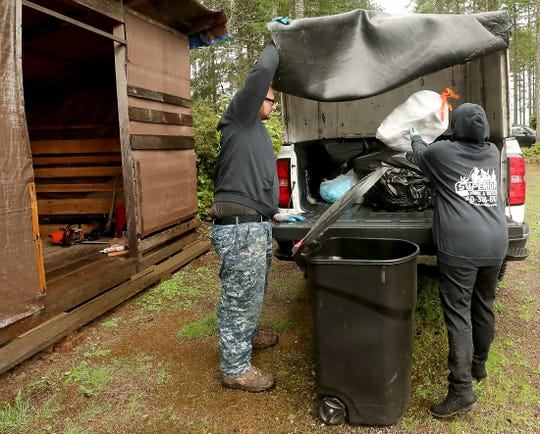 Daniel Stein of Superior Waste and Recycle, and his sister Tammy Stein collect trash from one of their clients in Seabeck on Friday, April 5, 2019.