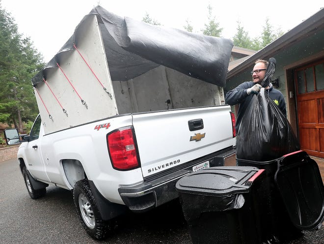 Daniel Stein of Superior Waste and Recycle collects trash from one of their clients in Seabeck on Friday, April 5, 2019.