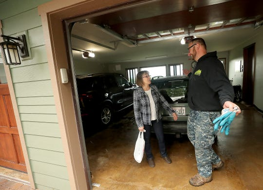 Lynda Lamb chats with Daniel Stein of Superior Waste and Recycle after Stein collected her trash from her Seabeck home on on Friday, April 5, 2019.