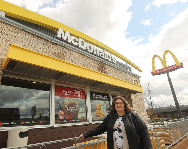 Susan Fenwick stands at the McDonald's on Wheaton Way in Bremerton. Fenwick has worked for the fast food company since she was a teenager and has been able to earn her high school and college degrees along the way.
