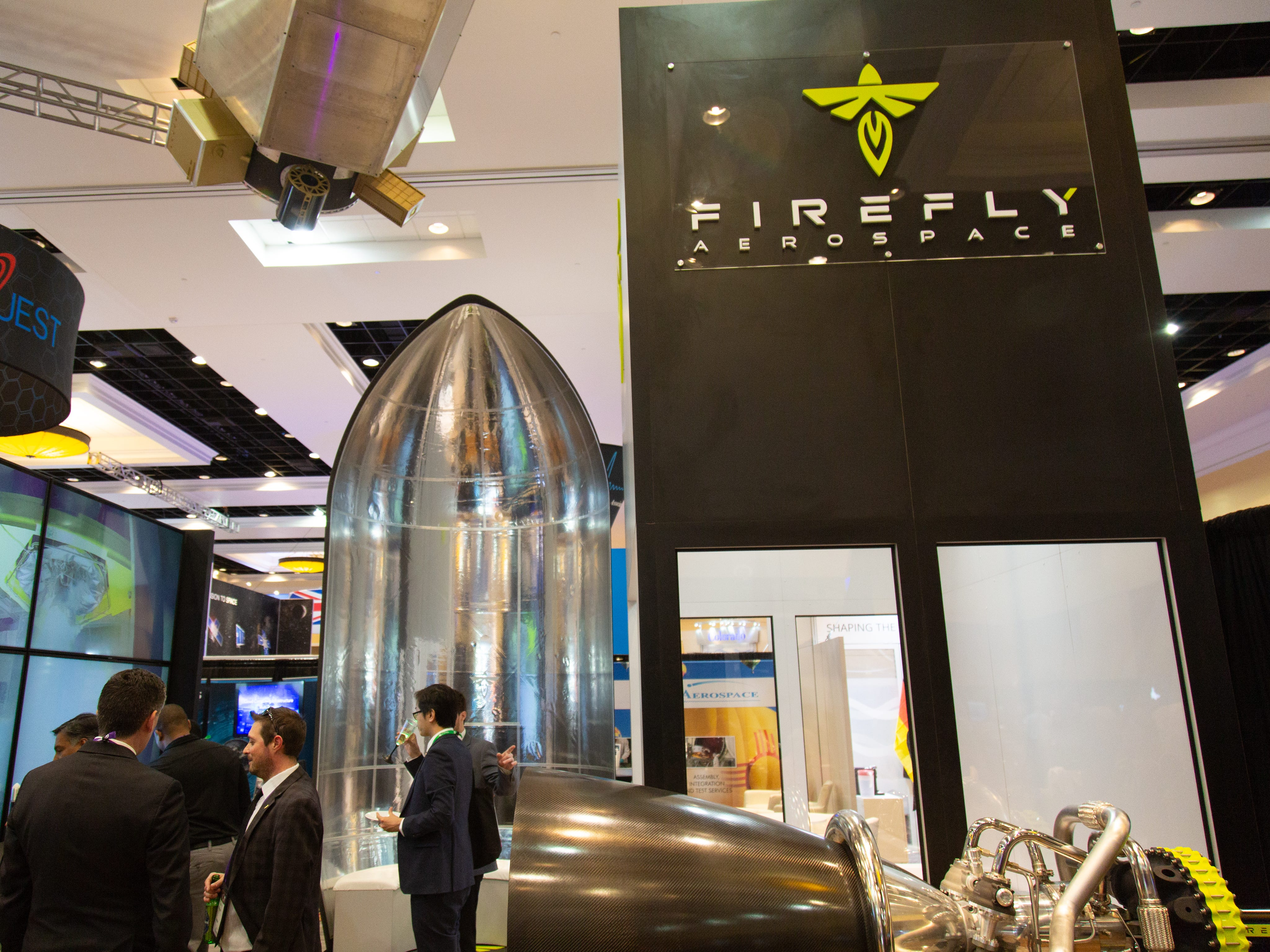 Firefly Aerospace's booth at the 35th Space Symposium in Colorado Springs features a rocket engined and mock payload fairing.