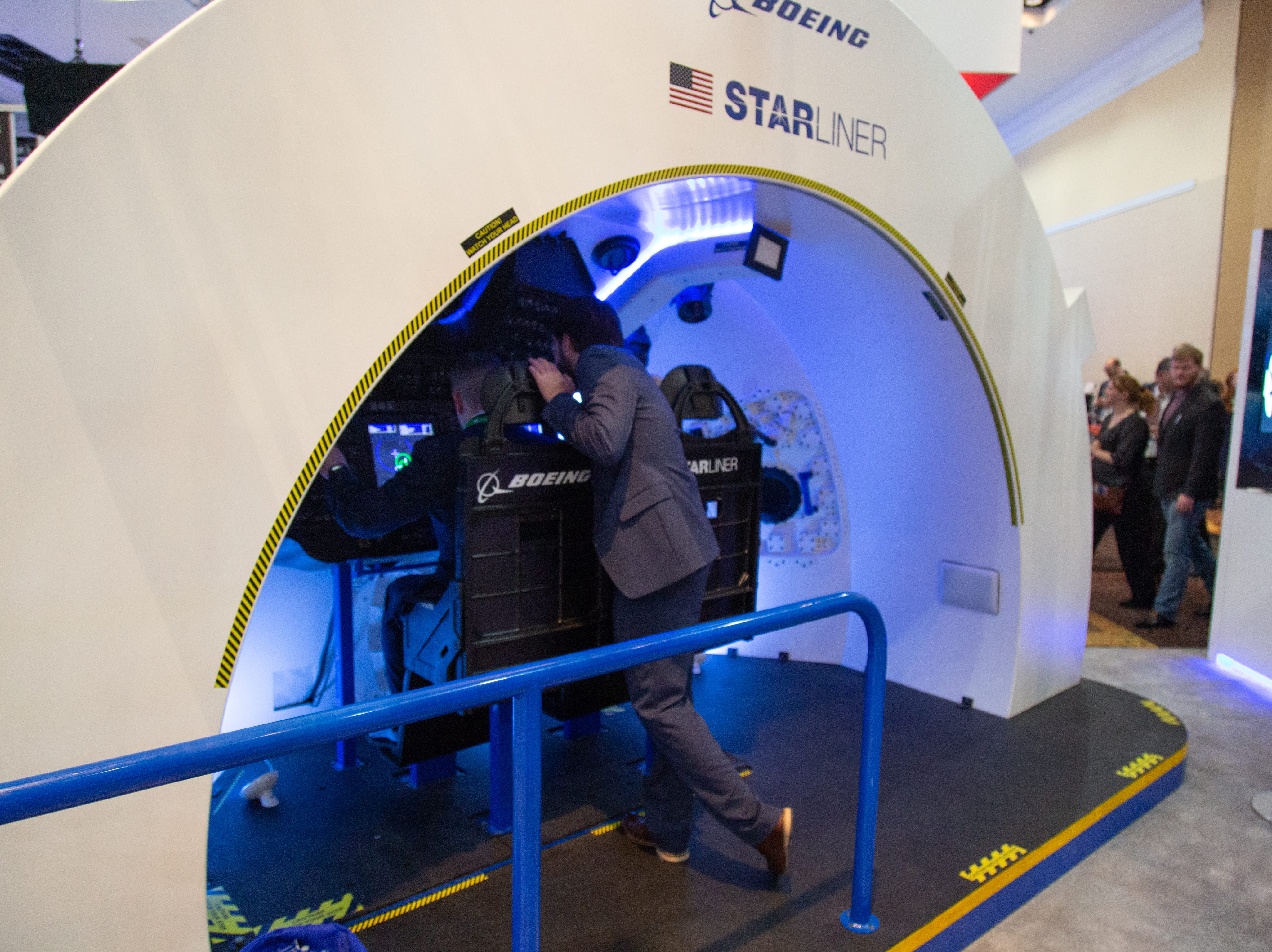 A Boeing Starliner simulator at the 35th Space Symposium.