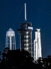 A SpaceX Falcon Heavy rocket sits upright on Pad 39A at Kennedy Space Center.