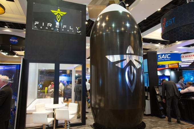 Firefly Aerospace's exhibit at the 35th Space Symposium includes a life-sized replica of a payload fairing.