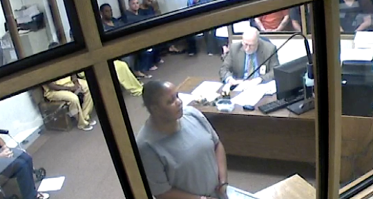 Guettie Belizaire, 39, appears before a judge at the Brevard County Jail after being charged with lewd and lascivious molestation of an elderly person.
