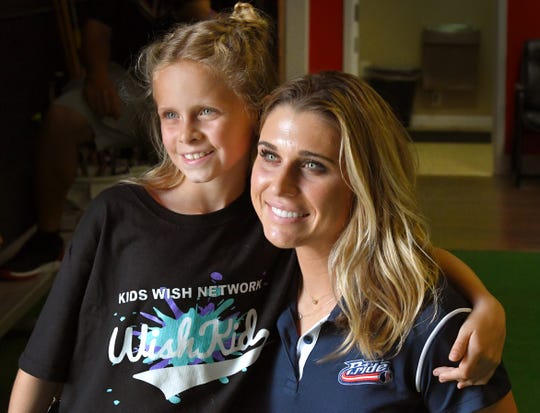Brookelynn Dolin, 10, of Melbourne has not let several life-altering illnesses keep her from playing softball. She got to hang out with her favorite professional player, Alex Powers, of the Viera-based USSSA Pride through a meeting set up by the Kids Wish Network.