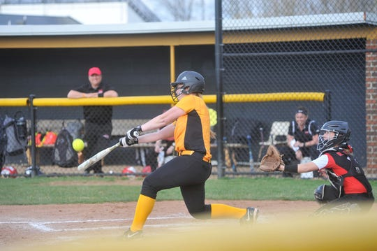 Colonel Crawford's Mariah Cotsamire swings at a pitch.