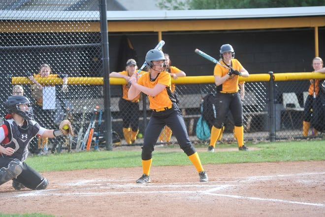 Colonel Crawford's Kaylyn Risner lets a wide pitch go past her.