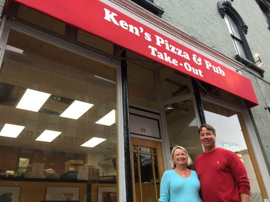 Deb and Tom Miller, owners of Ken's Pizza & Pub, stand outside the new take-out space on Bank Street in Burlington on April 8, 2019.