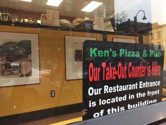 Ken's Pizza & Pub moved its take-out counter to Bank Street after Burlington Records moved to College Street.