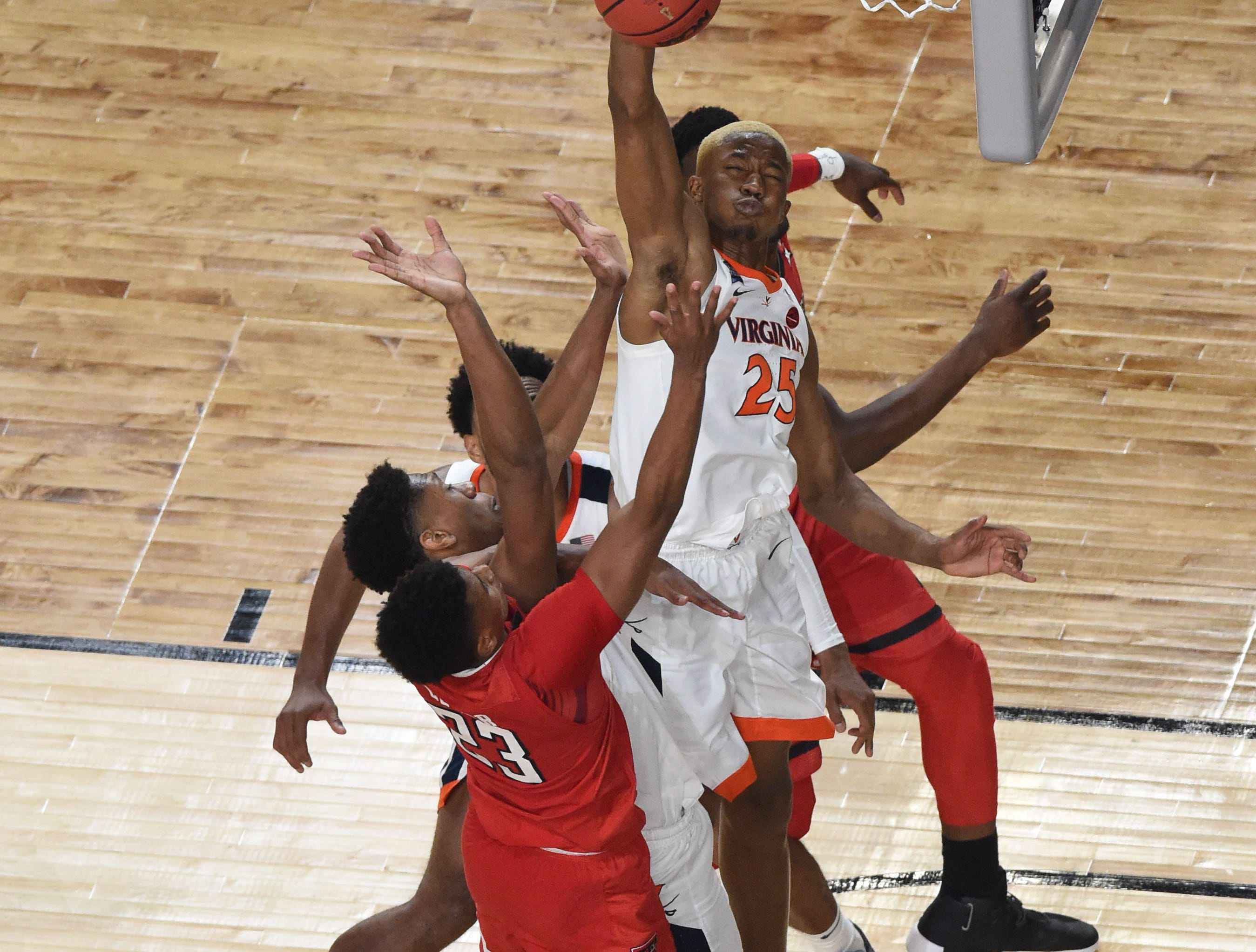 Apr 8, 2019; Minneapolis, MN, USA; Texas Tech Red Raiders guard Jarrett Culver (23) attempts a shot as Virginia Cavaliers forward Mamadi Diakite (25) goes for the block during the second half  in the championship game of the 2019 men's Final Four at US Bank Stadium. Mandatory Credit: Bob Donnan-USA TODAY Sports