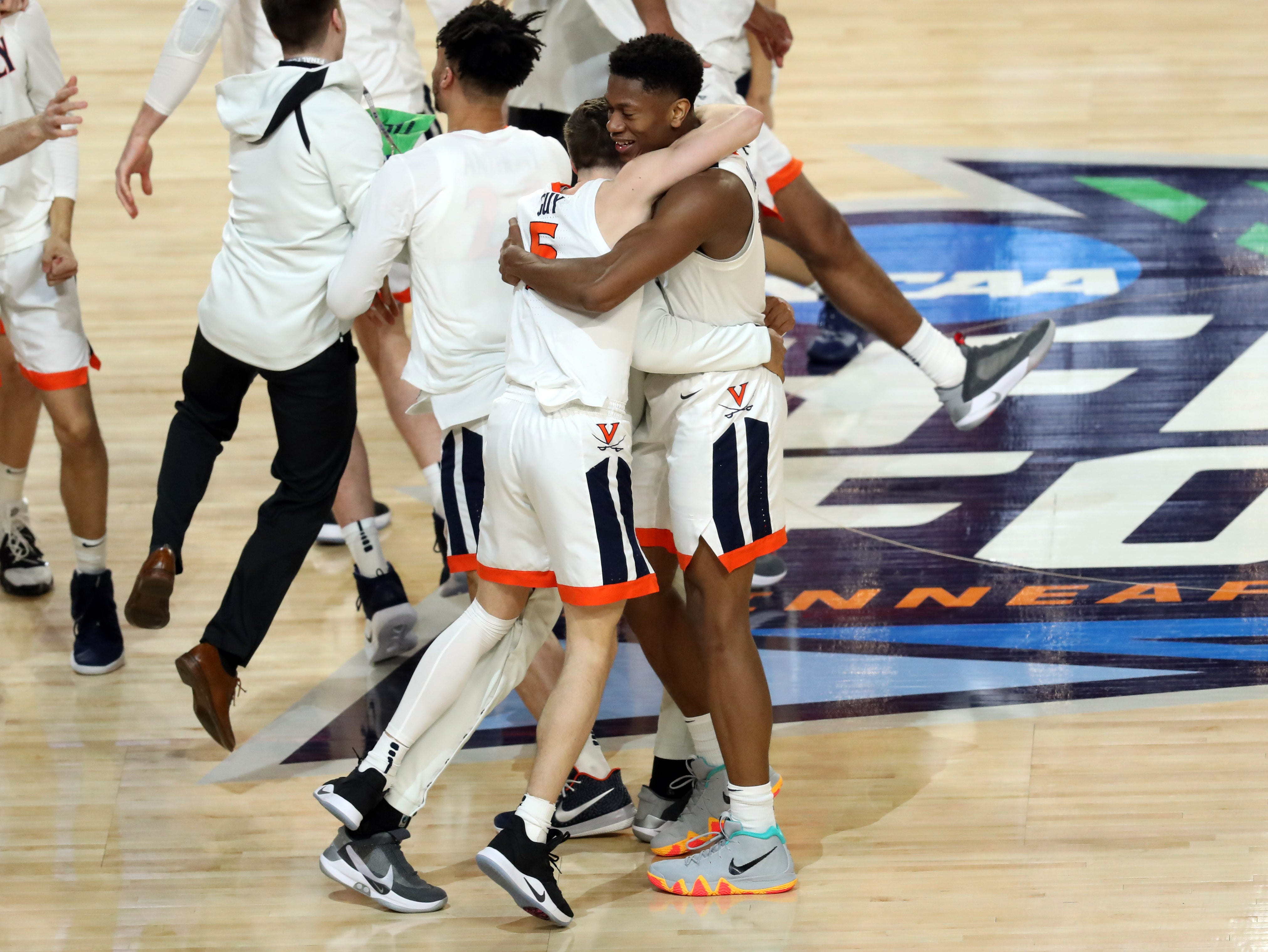 Apr 8, 2019; Minneapolis, MN, USA; Virginia Cavaliers guard Kyle Guy (5) and guard De'Andre Hunter (12) embrace after defeating the Texas Tech Red Raiders in the championship game of the 2019 men's Final Four at US Bank Stadium. Mandatory Credit: Brace Hemmelgarn-USA TODAY Sports