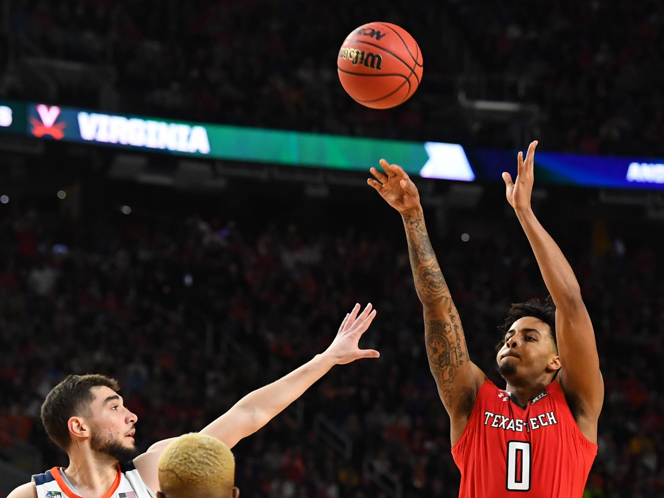 Apr 8, 2019; Minneapolis, MN, USA; Texas Tech Red Raiders guard Kyler Edwards (0) shoots the ball over Virginia Cavaliers guard Ty Jerome (11) in the championship game of the 2019 men's Final Four at US Bank Stadium. Mandatory Credit: Robert Deutsch-USA TODAY Sports