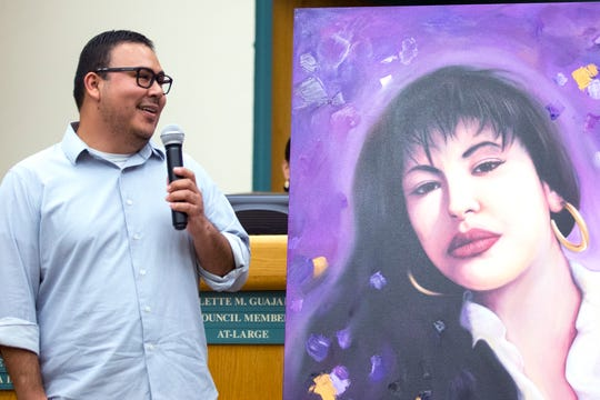 Corpus Christi artist Gilbert Cantu addresses the audience about his painting of the late Tejano singer Selena Quintanilla-Perez on April 9, 2019. The painting was donated to the city, ahead of the Fiesta De La Flor festival.