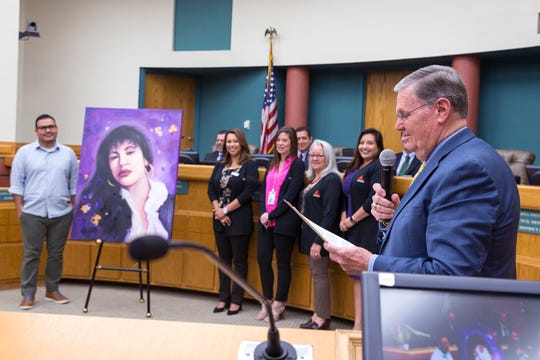 """Corpus Christi Mayor Joe McComb proclaims Friday and Saturday """"Fiesta de la Flor"""" days during the city council meeting on Tuesday, April 9, 2019.. A painting by artist Gilbert Cantu of the late Tejano singer Selena Quintanilla-Perez was donated to the city, ahead of the Fiesta De La Flor festival."""