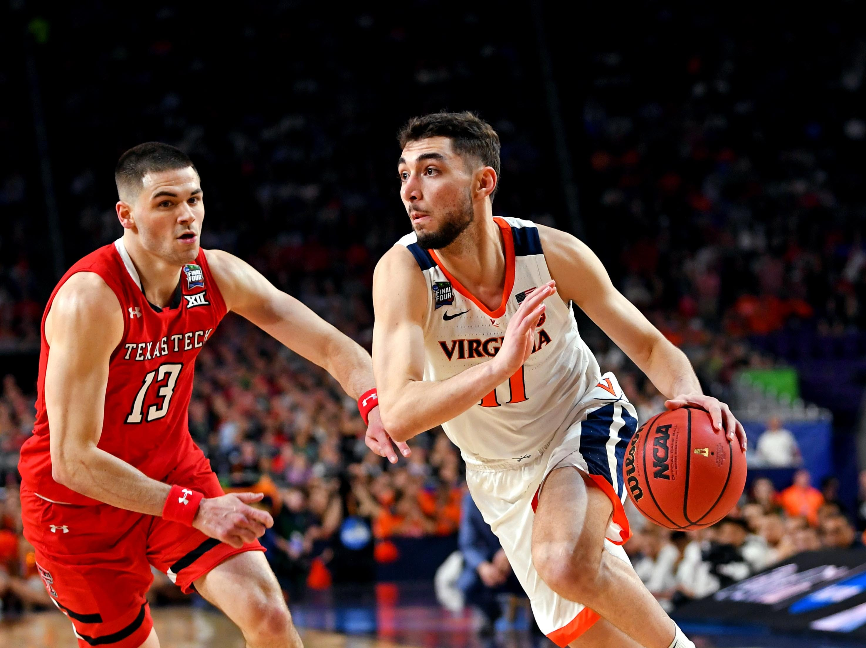Apr 8, 2019; Minneapolis, MN, USA; Virginia Cavaliers guard Ty Jerome (11) drives to the basket against Texas Tech Red Raiders guard Matt Mooney (13) during the first half in the championship game of the 2019 men's Final Four at US Bank Stadium. Mandatory Credit: Bob Donnan-USA TODAY Sports