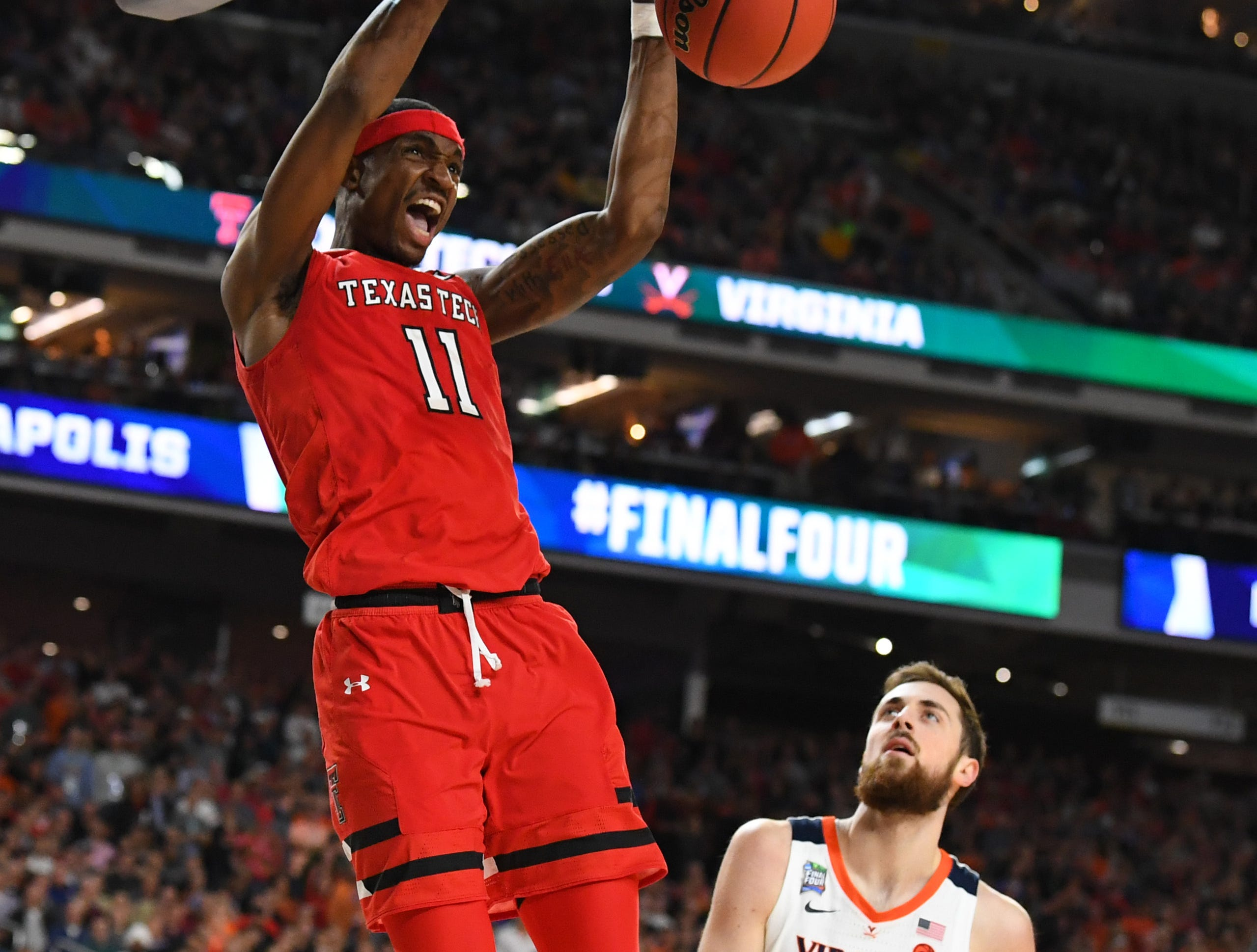 Apr 8, 2019; Minneapolis, MN, USA; Texas Tech Red Raiders forward Tariq Owens (11) dunks the ball past Virginia Cavaliers forward Jay Huff (30) in the championship game of the 2019 men's Final Four at US Bank Stadium. Mandatory Credit: Robert Deutsch-USA TODAY Sports