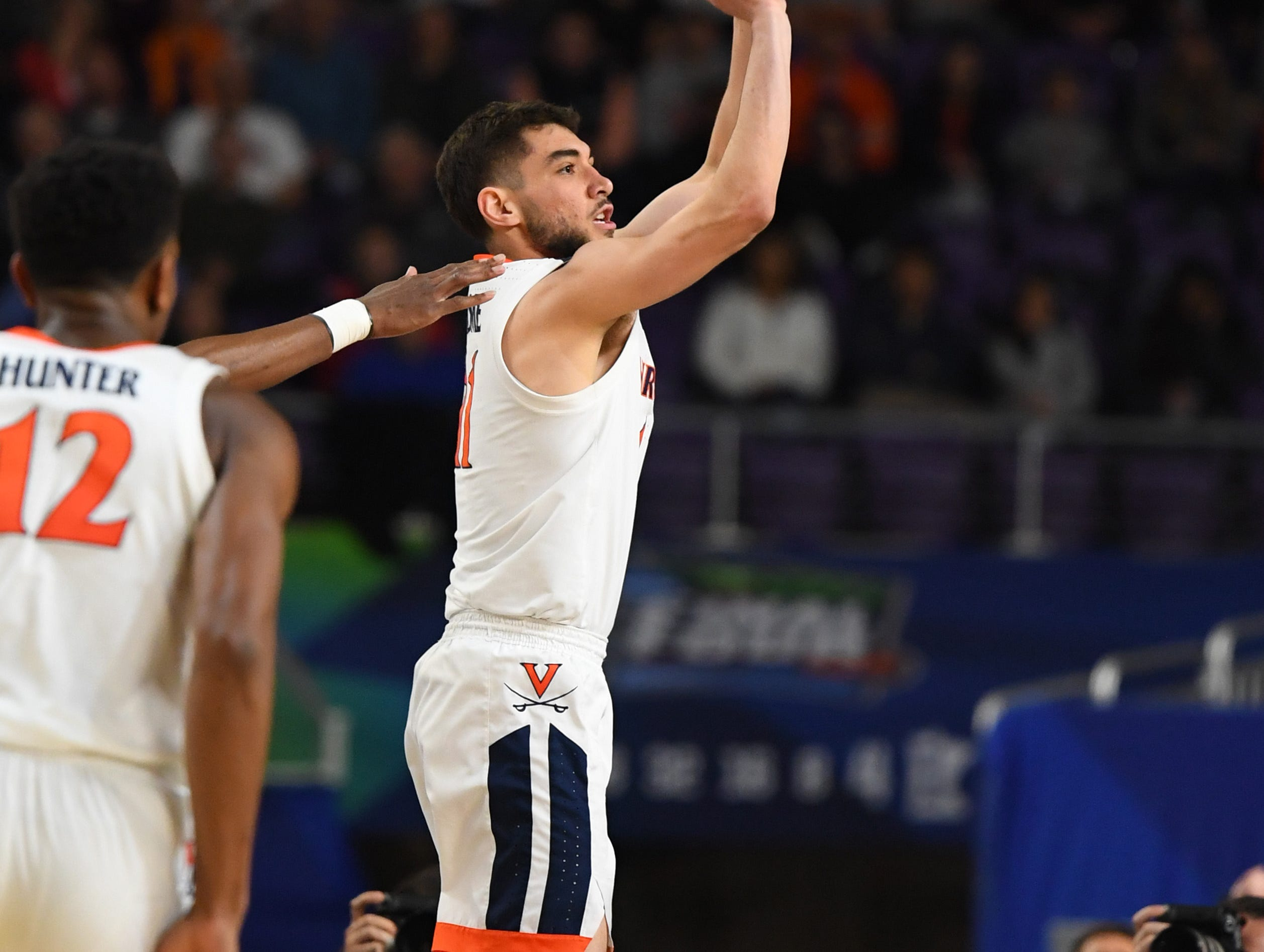 Apr 8, 2019; Minneapolis, MN, USA; Virginia Cavaliers guard Ty Jerome (11) hits a three-point shot against the Texas Tech Red Raiders in the championship game of the 2019 men's Final Four at US Bank Stadium. Mandatory Credit: Robert Deutsch-USA TODAY Sports