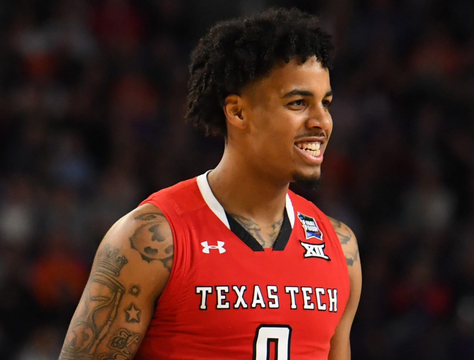 Apr 8, 2019; Minneapolis, MN, USA; Texas Tech Red Raiders guard Kyler Edwards (0) reacts after a score against the Virginia Cavaliers in the championship game of the 2019 men's Final Four at US Bank Stadium. Mandatory Credit: Robert Deutsch-USA TODAY Sports
