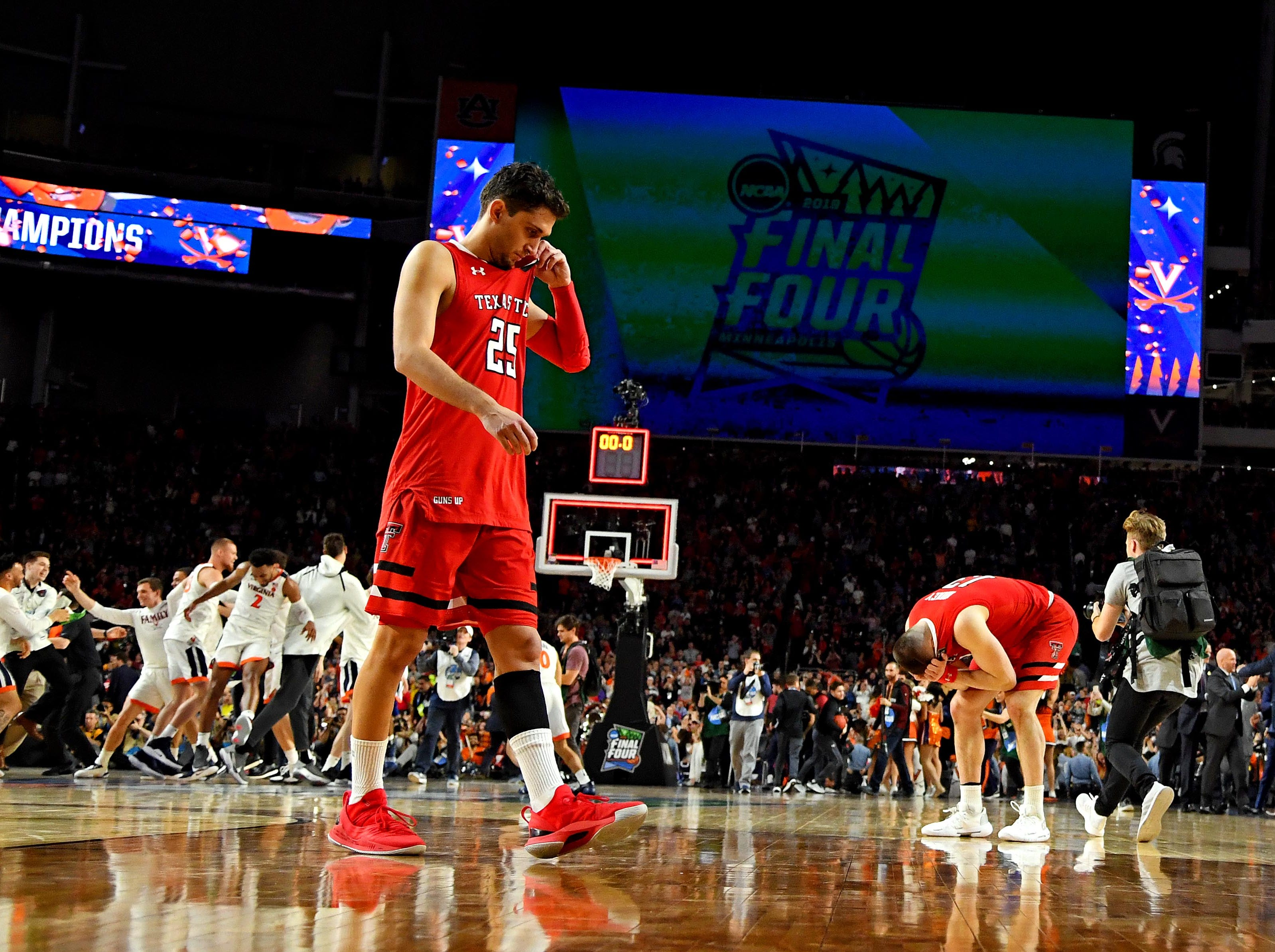 Apr 8, 2019; Minneapolis, MN, USA; Texas Tech Red Raiders guard Davide Moretti (25) and guard Matt Mooney (13) react after losing to the Virginia Cavaliers in the championship game of the 2019 men's Final Four at US Bank Stadium. Mandatory Credit: Bob Donnan-USA TODAY Sports