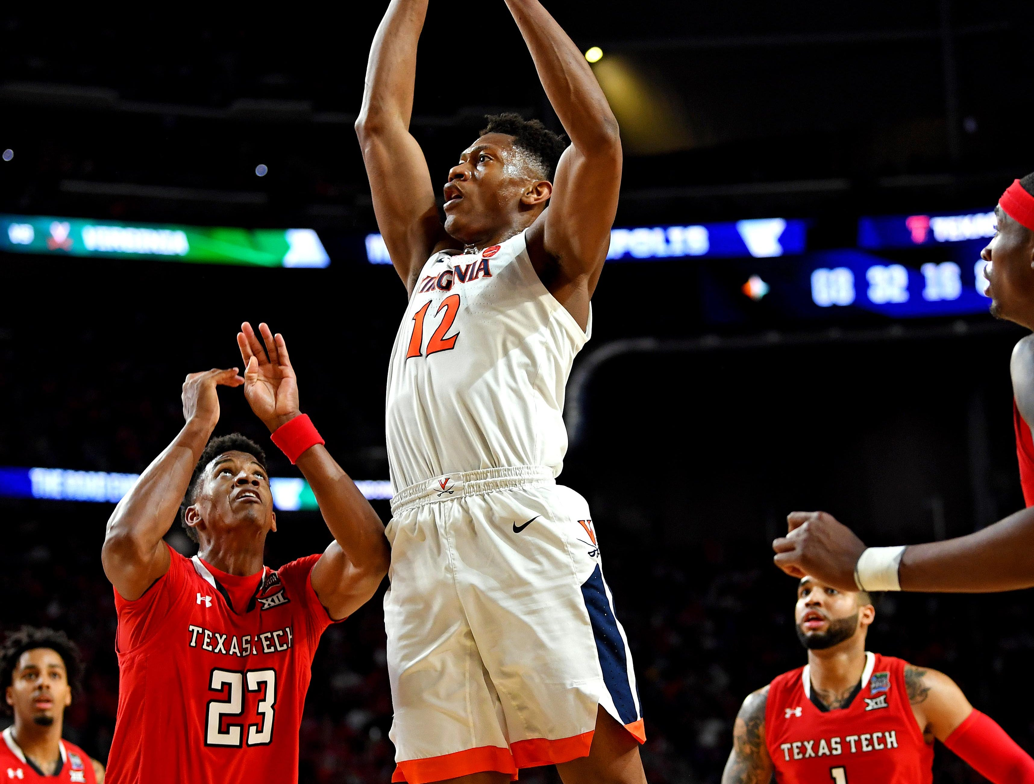 Apr 8, 2019; Minneapolis, MN, USA; Virginia Cavaliers guard De'Andre Hunter (12) shoots the ball against Texas Tech Red Raiders guard Jarrett Culver (23) during the first half in the championship game of the 2019 men's Final Four at US Bank Stadium. Mandatory Credit: Bob Donnan-USA TODAY Sports