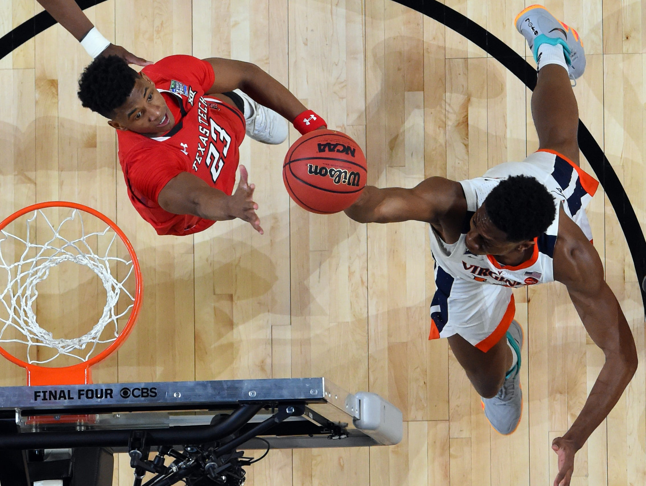 Apr 8, 2019; Minneapolis, MN, USA; Virginia Cavaliers guard De'Andre Hunter (in white) goes up for a shot as Texas Tech Red Raiders guard Jarrett Culver (23) defends during the first half in the championship game of the 2019 men's Final Four at US Bank Stadium. Mandatory Credit: Bob Donnan-USA TODAY Sports