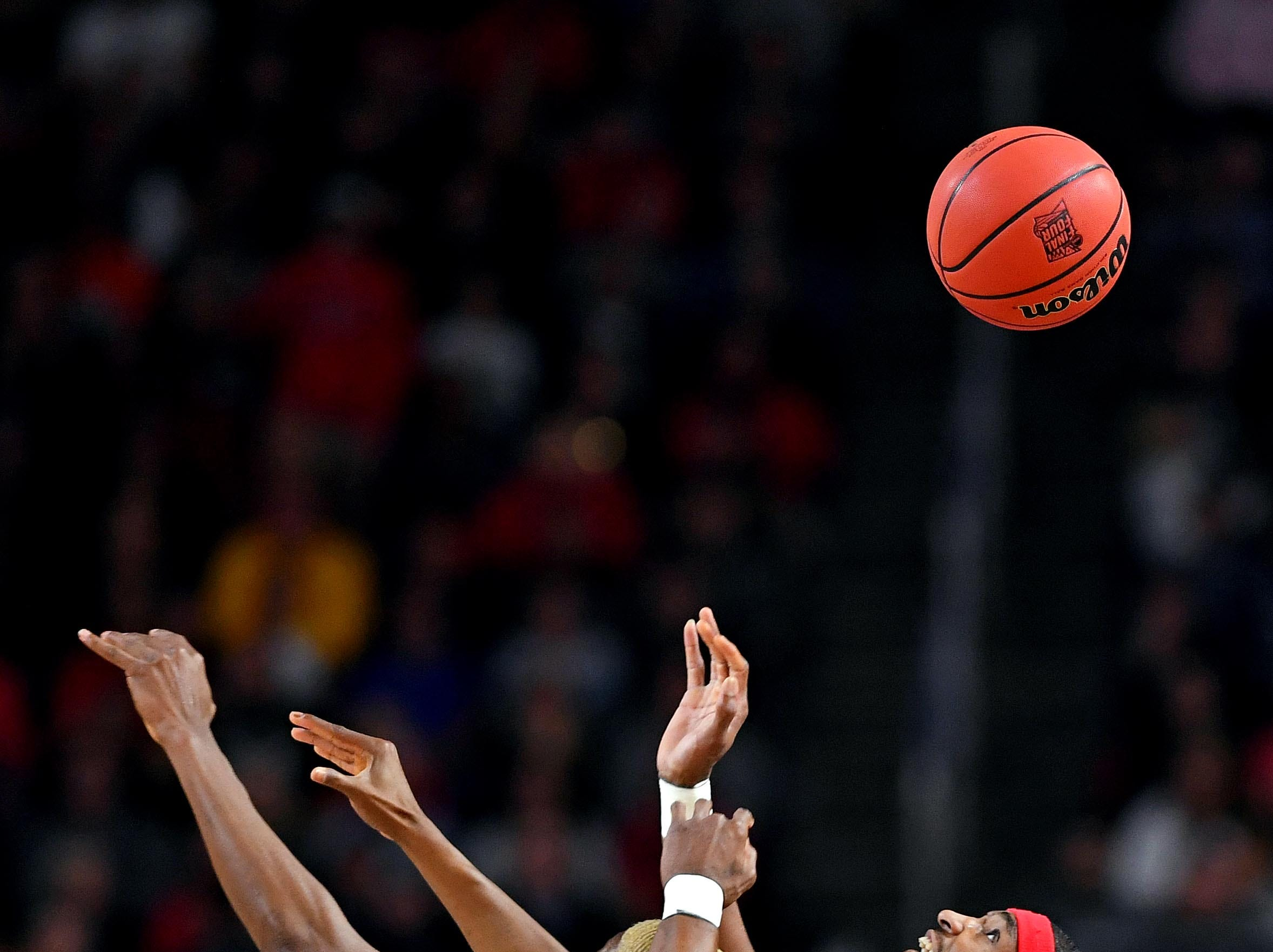 Apr 8, 2019; Minneapolis, MN, USA; Texas Tech Red Raiders forward Tariq Owens (11) and Virginia Cavaliers forward Mamadi Diakite (25) go for a rebound in the championship game of the 2019 men's Final Four at US Bank Stadium. Mandatory Credit: Bob Donnan-USA TODAY Sports