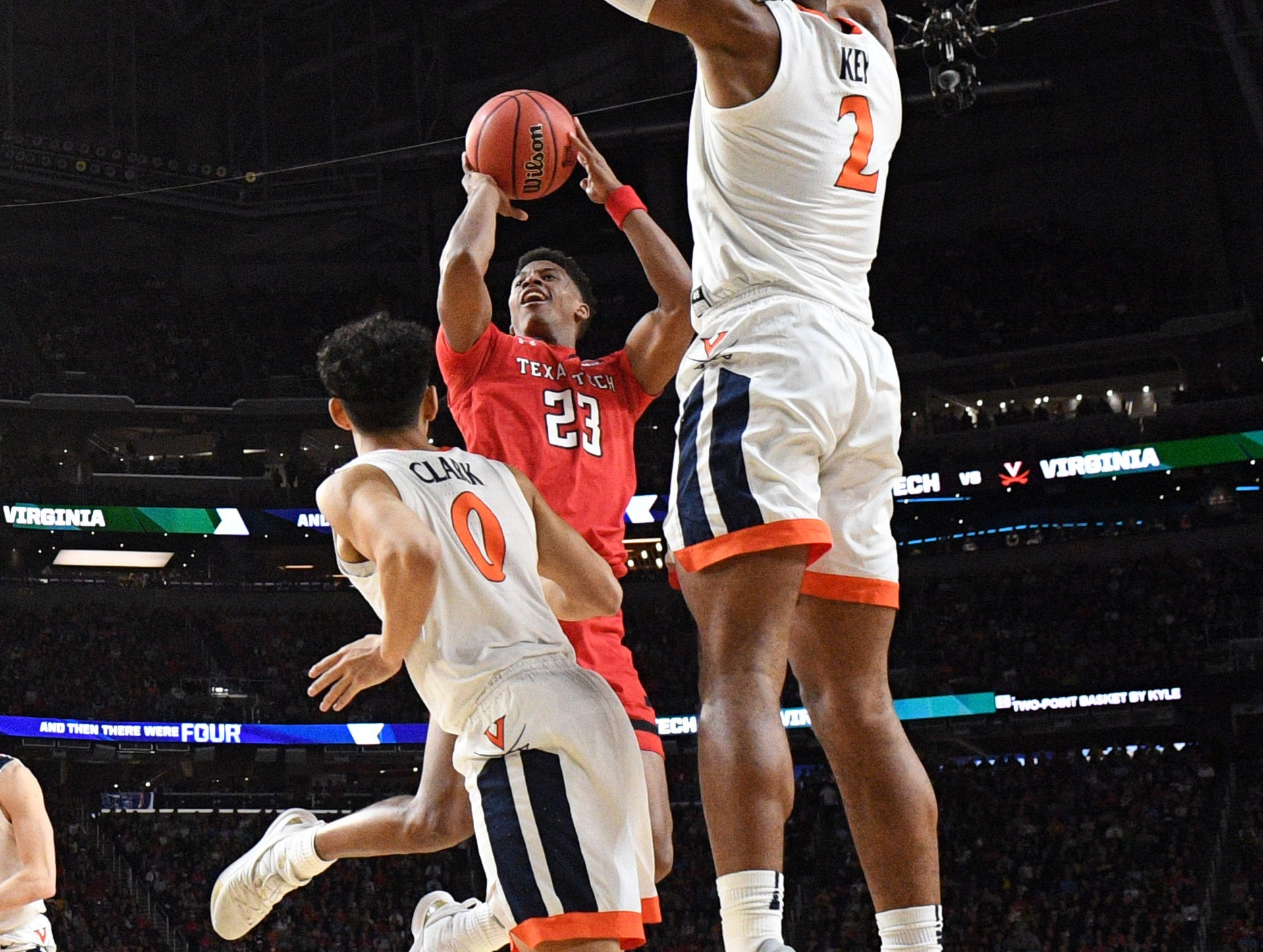 Apr 8, 2019; Minneapolis, MN, USA; Texas Tech Red Raiders guard Jarrett Culver (23) shoots the ball defended by Virginia Cavaliers guard Braxton Key (2) and guard Kihei Clark (0) in the championship game of the 2019 men's Final Four at US Bank Stadium. Mandatory Credit: Robert Deutsch-USA TODAY Sports