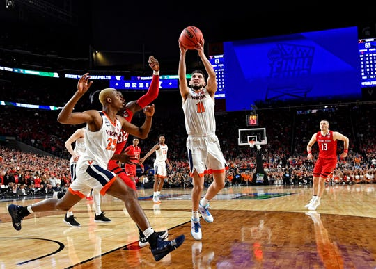 Apr 8, 2019; Minneapolis, MN, USA; Virginia Cavaliers guard Ty Jerome (11) grabs a rebound against Texas Tech Red Raiders center Norense Odiase (32) during the second half in the championship game of the 2019 men's Final Four at US Bank Stadium. Mandatory Credit: Bob Donnan-USA TODAY Sports
